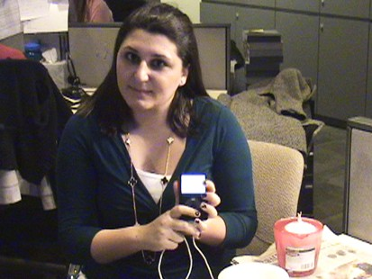 Picture of Emily Friedman holding an iPod.