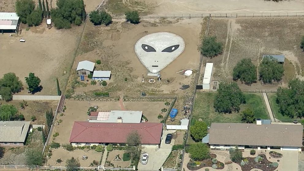 """Larry Decker, 77, said he and his family created a 60-by-90 alien face out of rocks in his backyard in Romoland, California, """"in the hopes of inviting aliens"""" to his home."""