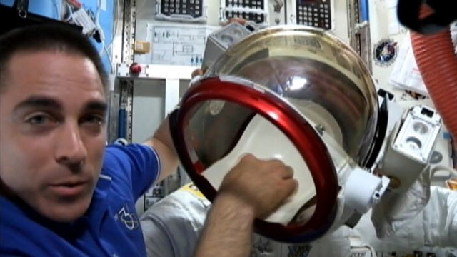 VIDEO: Astronaut Chris Cassidy shows possible sources of fluid that drained into Luca Parmitanos helmet.