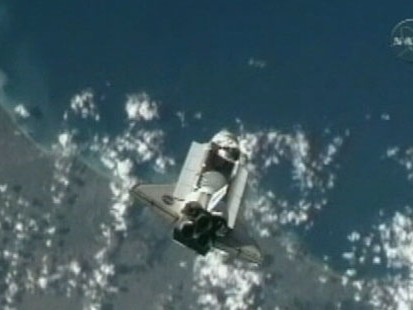 VIDEO: Space shuttle Discovery approaches space station for 9-day visit.