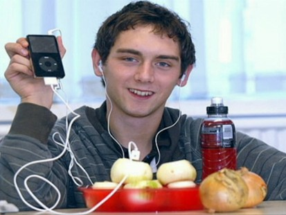 Picture of boy with an iPod and onion.