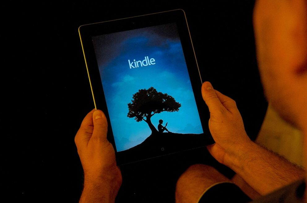 PHOTO: A man is seen using the Amazon Kindle application on an iPad, Nov. 2, 2017.