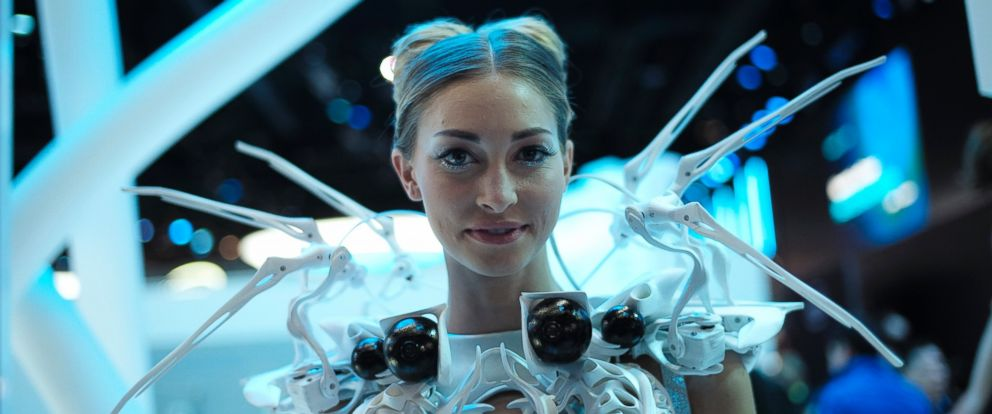 PHOTO: A model wearing robotic dress with proximity sensors pauses for photos at the Intel booth at the International CES, Tuesday, Jan. 6, 2015, in Las Vegas.