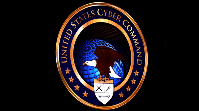 PHOTO: The new U.S. Cyber Command logo is displayed during the activation ceremony of USCYBERCOM at Ft. Meade, MD.