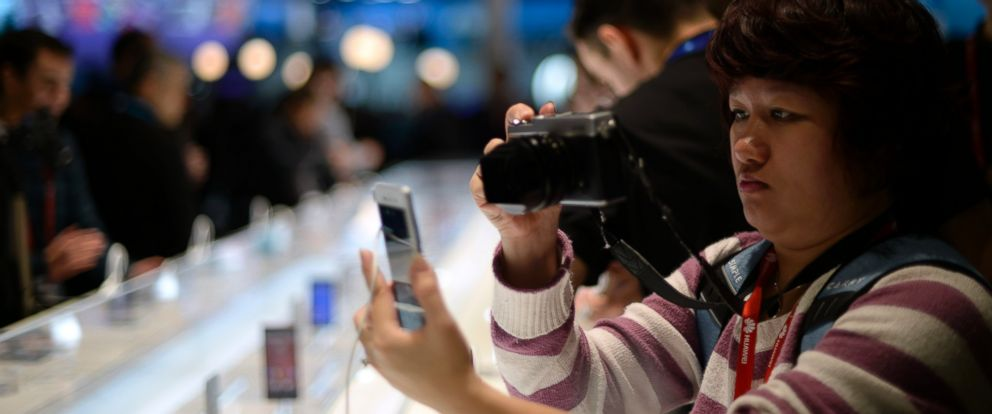 PHOTO: An attendee takes a picture of a device at the Mobile World Congress, the worlds largest mobile phone trade show in Barcelona, Spain, on March 2, 2015.