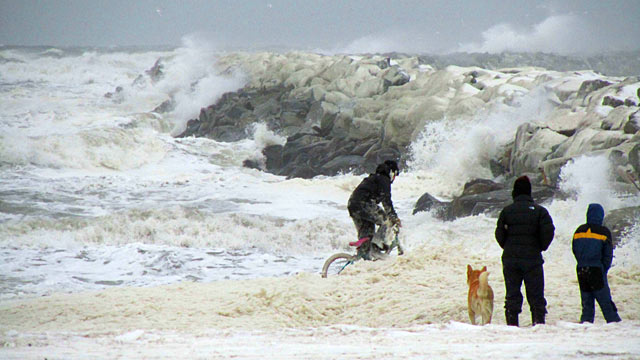 PHOTO: Nome kids plays in sea foam near the Nome harbor, Nov. 8, 2011 as the big Bering Sea storm starts kicking up in Nome, Alaska.