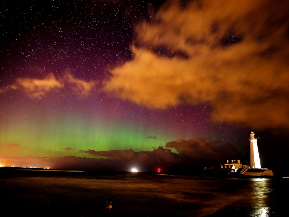 PHOTO: The Northern Lights, or Aurora Borealis, shine over St Marys Lighthouse near Whitley Bay in Northumberland, northeast England early March 7, 2016.
