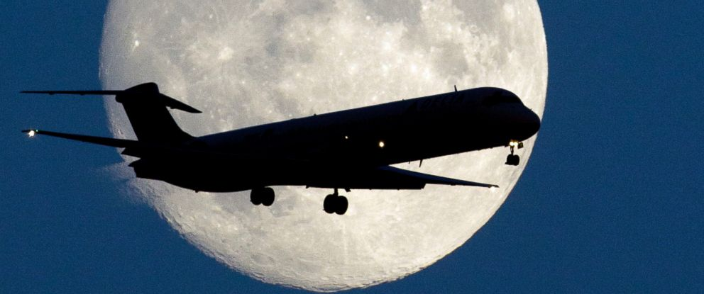 PHOTO: An airplane passes a nearly full moon as it makes its approach to Philadelphia International Airport on Sept. 7, 2014 in Philadelphia.