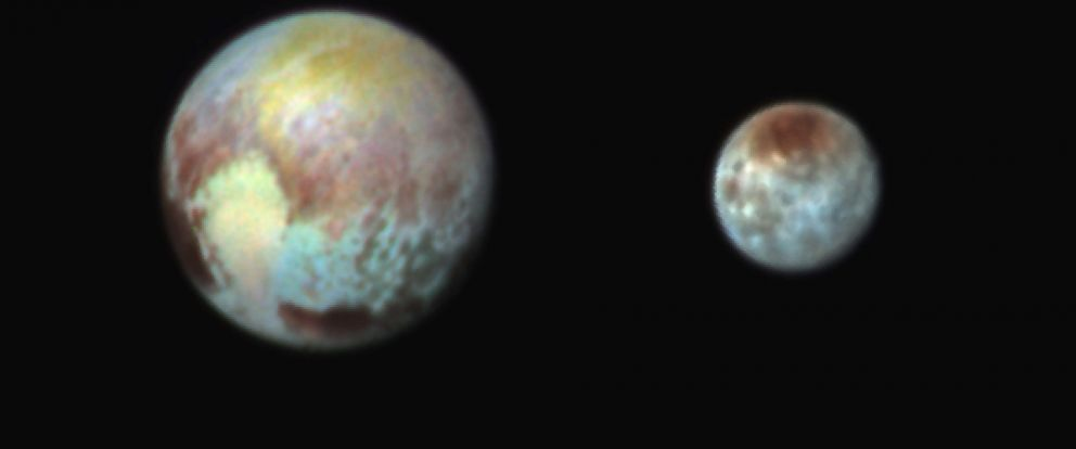 PHOTO: This Monday, July 13, 2015 combination image released by NASA shows Pluto, left, and its moon, Charon, in exaggerated colors made by using different filters on a camera aboard the New Horizons spacecraft.