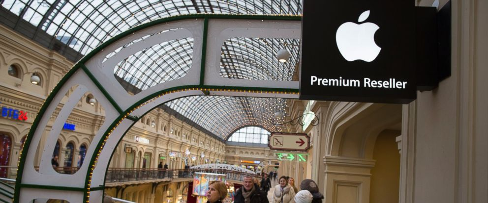 PHOTO: In this photo taken on Friday, Nov. 28, 2014, customers walk outside an Apple Premium reseller inside the Moscow GUM shopping mall in Moscow, Russia.