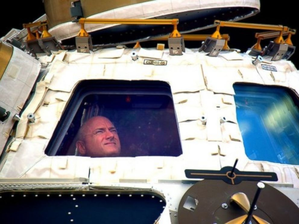 PHOTO: In this undated photo provided by NASA on March 1, 2016, astronaut Scott Kelly looks out the cupola of the International Space Station.