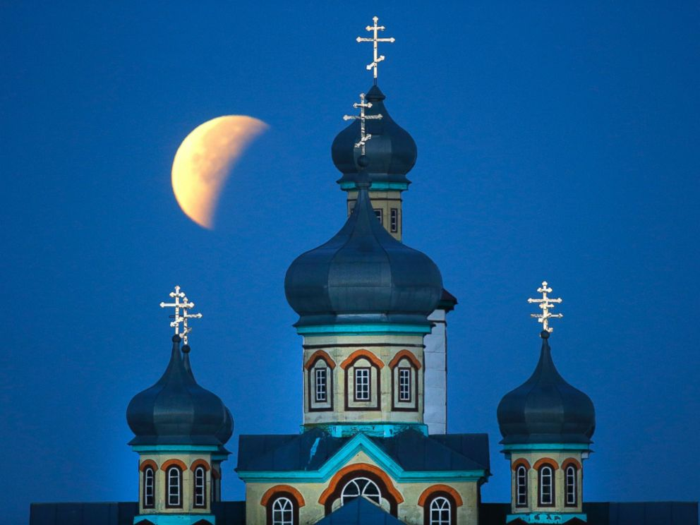 PHOTO: A supermoon is seen at the finish of a lunar eclipse behind an Orthodox church in Turets, Belarus, Sept. 28, 2015.
