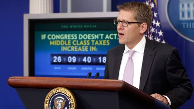 PHOTO: A middle class tax increase countdown clock is seen behind White House Press Secretary Jay Carney as he briefs reporters after President Barack Obama made a statement in the Press Briefing Room of the White House on Dec. 5, 2011.