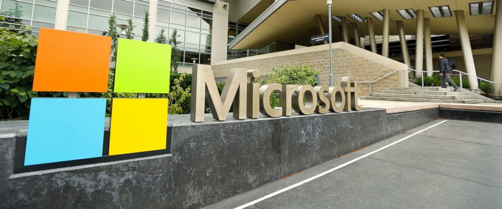 PHOTO: This July 3, 2014 file photo shows Microsoft Corp. signage outside the Microsoft Visitor Center in Redmond, Wash.
