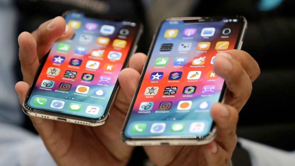The iPhone XS, left, and XS Max are displayed side to side during an event to announce new products at Apple headquarters Wednesday, Sept. 12, 2018, in Cupertino, Calif.