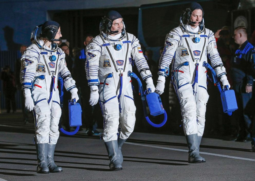 PHOTO: From left, U.S. astronaut Christina Hammock Koch, Russian cosmonaut Alexey Ovchinin, and U.S. astronaut Nick Hague walk in their space suits prior the launch of Soyuz MS-12 space ship at the Baikonur cosmodrome, Kazakhstan, March 14, 2019.