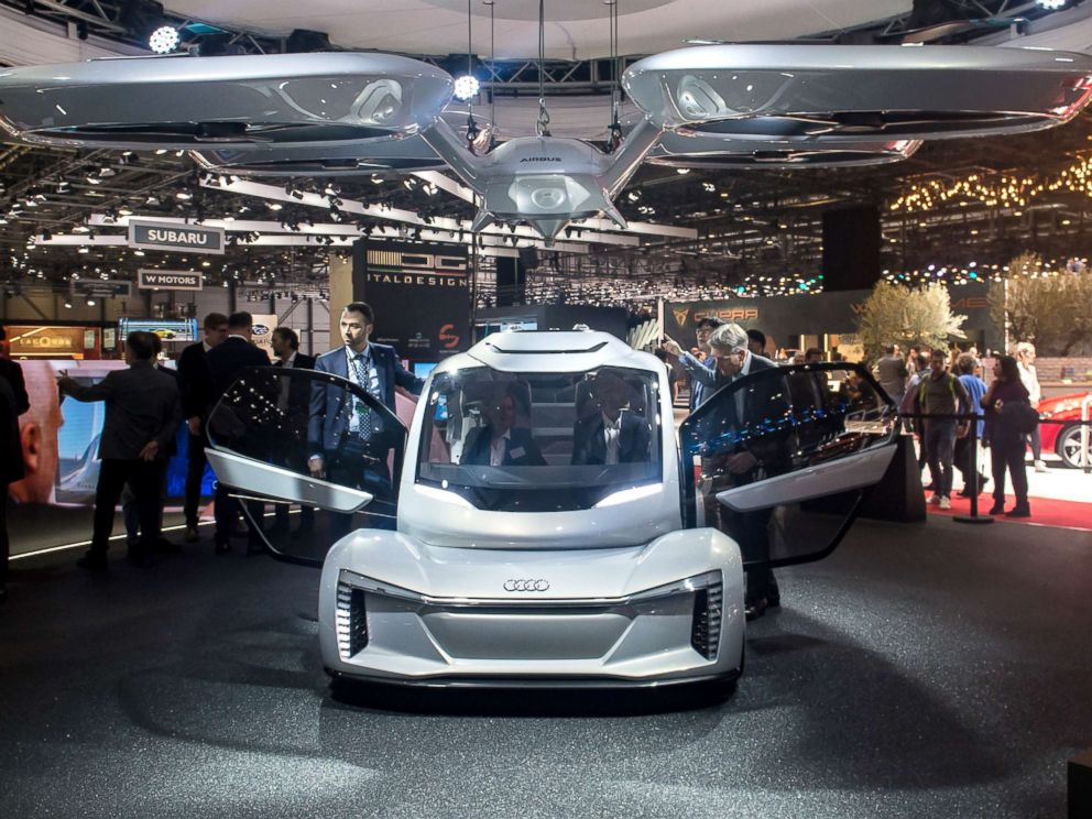 PHOTO: The Pop.up next concept flying car, a hybrid vehicle that blends a self-driving car and passenger drone by Audi, italdesign and Airbus is seen at the 88th Geneva International Motor Show, March 6, 2018, in Geneva, Switzerland.
