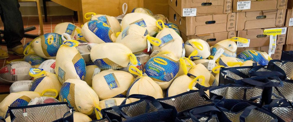 PHOTO: Frozen turkeys and thermal grocery bags filled with food items sit ready for distribution to pre-selected Team Dover military families Nov. 18, 2016, at the Landings on Dover Air Force Base, Del.