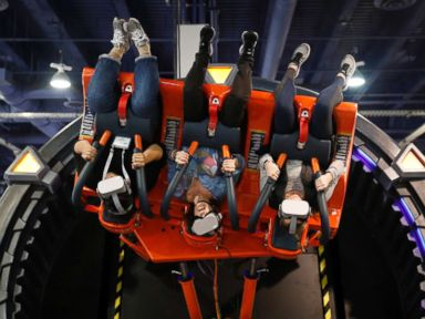PHOTO: People ride the Hurricane VR 360 at the DOF Robotics booth at CES, Jan. 9, 2019, in Las Vegas.