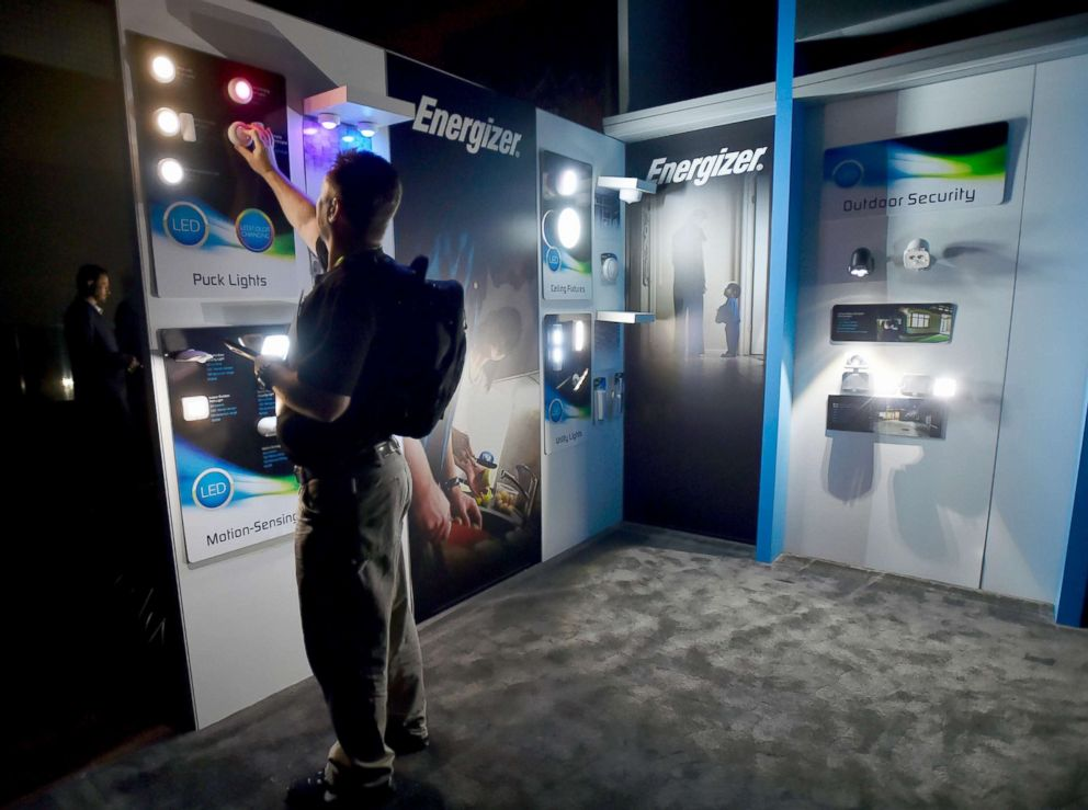 PHOTO: Attendee John Parmley looks over battery-operated lighting in the Jasco Products booth after power was lost during CES 2018 inside the central hall at the Las Vegas Convention Center, Jan. 10, 2018, in Las Vegas.