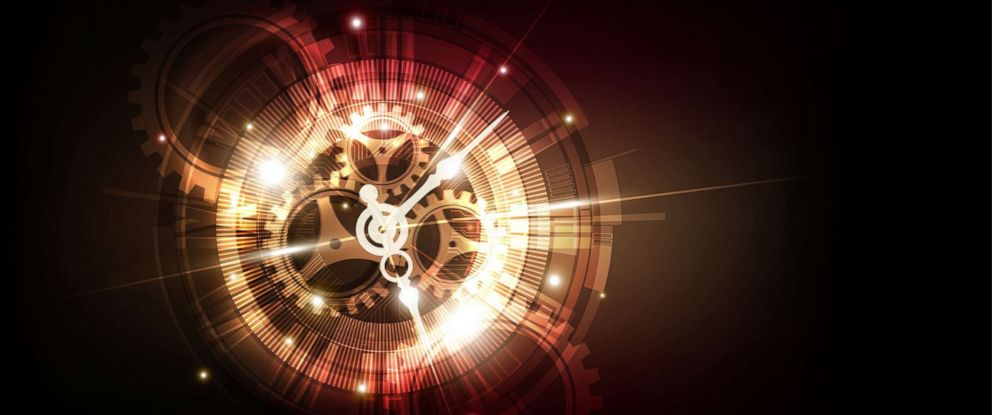 PHOTO: A stylized clock concept and time machine over an abstract background.