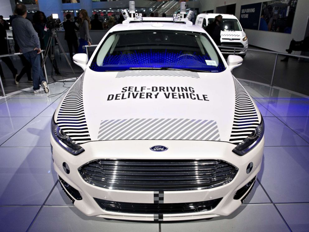 PHOTO: A Ford Motor Co. Fusion set-up as an experimental self-driving delivery vehicle sits on display during the 2018 North American International Auto Show (NAIAS) in Detroit, Michigan, Jan. 15, 2018.
