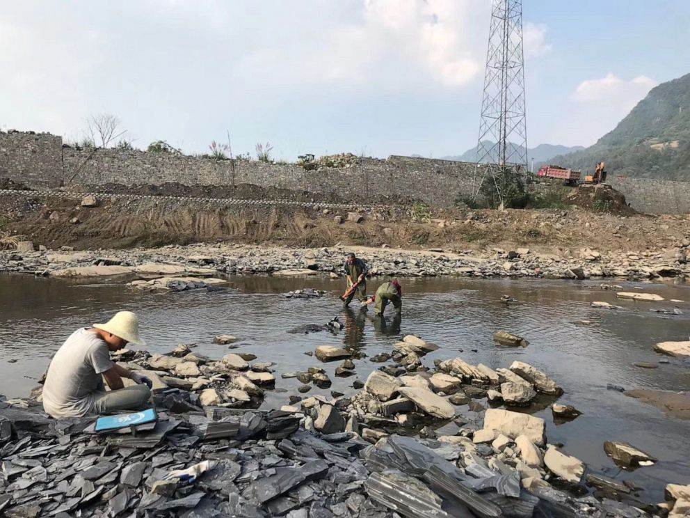 PHOTO: Researchers working on a river bed near the junction of the Danshui River with Qingjiang River in Hubei Province, China, March 26, 2019.