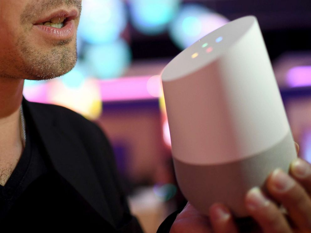 PHOTO: A young man shows the features of a Google Assistant speaker at an exhibition in Berlin, Sept. 1, 2017.
