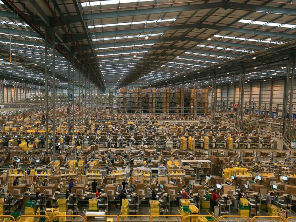 PHOTO: Employees work on the warehouse floor at one of Amazon.com Inc.s fulfillment centers, Nov. 25, 2014, in Peterborough, U.K.