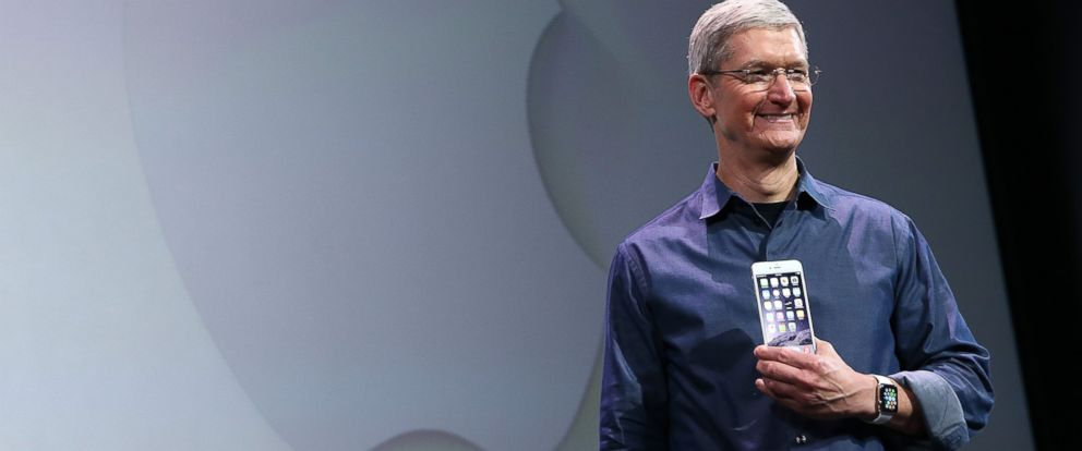 PHOTO: Tim Cook shows off the new iPhone 6 and the Apple Watch during an Apple special event at the Flint Center for the Performing Arts on Sept. 9, 2014 in Cupertino, California.