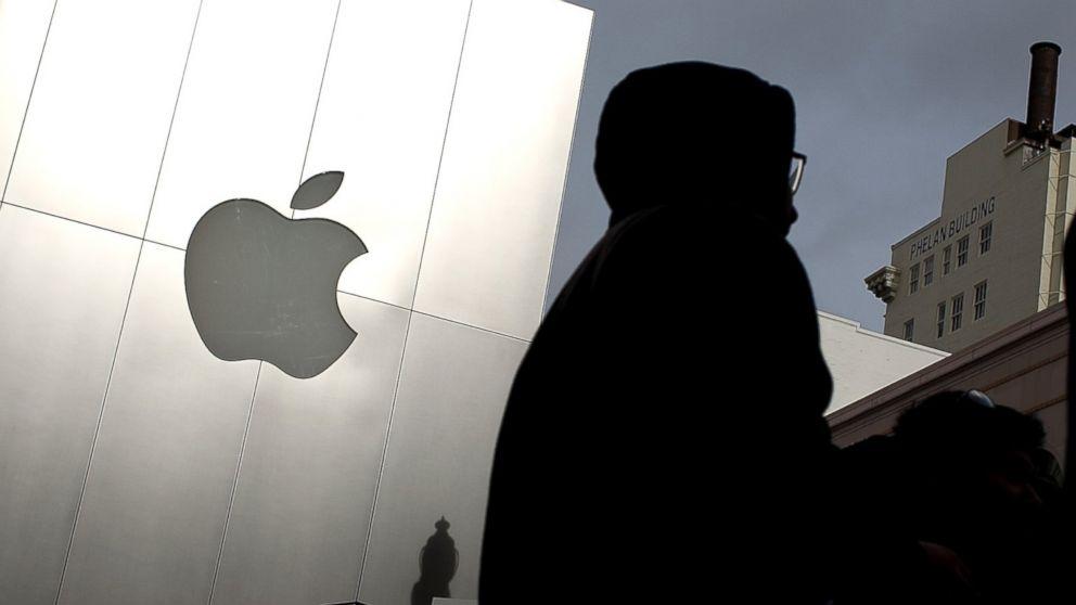 Pedestrians walk by an Apple Store in San Francisco, Calif. on Jan. 24, 2012.
