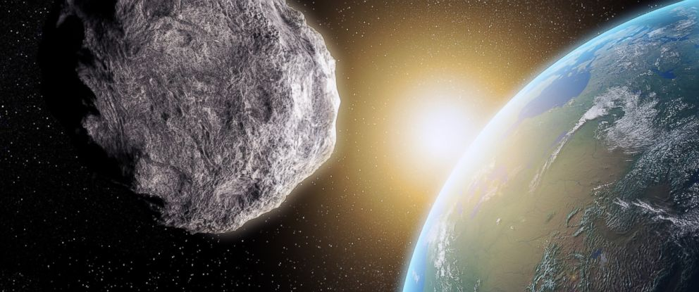 PHOTO:A computer generated stock image illustrates an asteroid near earth.