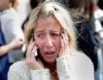 PHOTO: A concerned woman looking for a loved one talks on the phone at Mass. Avenue and Boylston Street after two explosions went off near the finish line of the 117th Boston Marathon on April 15, 2013.