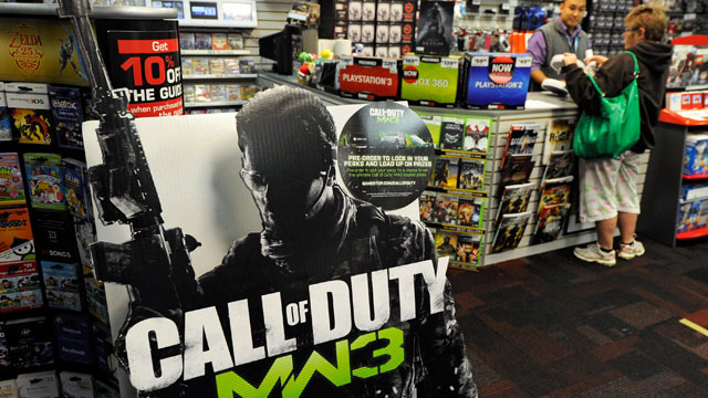 """PHOTO: A cardboard display advertises the highly anticipated video game, """"Call Of Duty: Modern Warfare 3"""" at a GameStop Corp. store."""