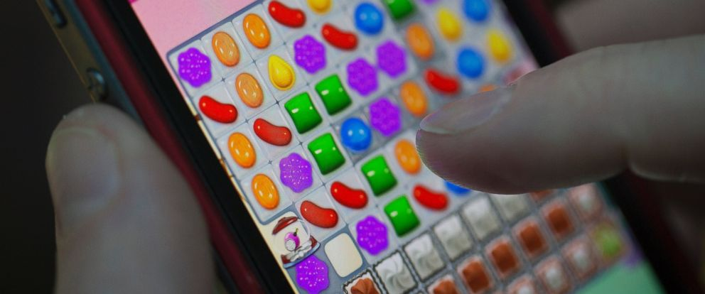 "PHOTO: A user plays ""Candy Crush Saga"" on a phone in London, Feb. 18, 2014."