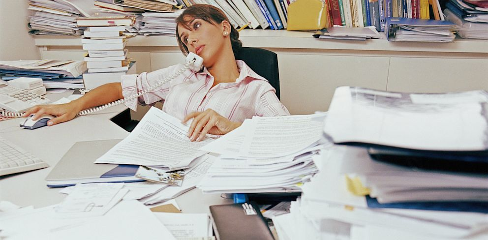 PHOTO: Woman with cluttered desk