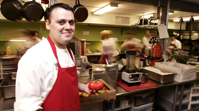 "PHOTO: Chef Homaro Cantu holds a tomato in the kitchen of his new restaurant called ""Moto"" in Chicago, Illinois, May, 15, 2007."