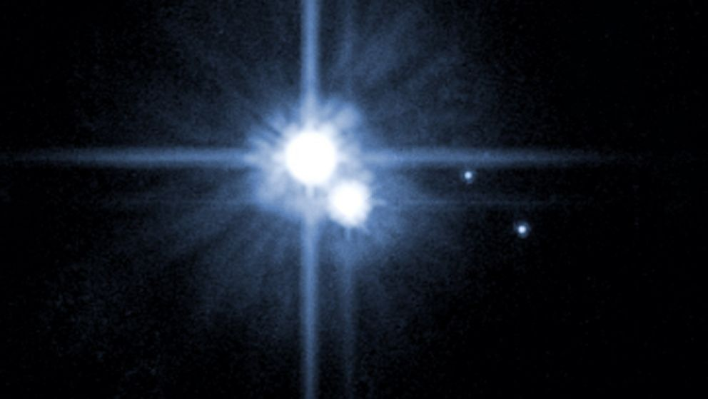 A Hubble Space Telescope image released by NASA in 2006 shows Pluto and three of it's five moons.