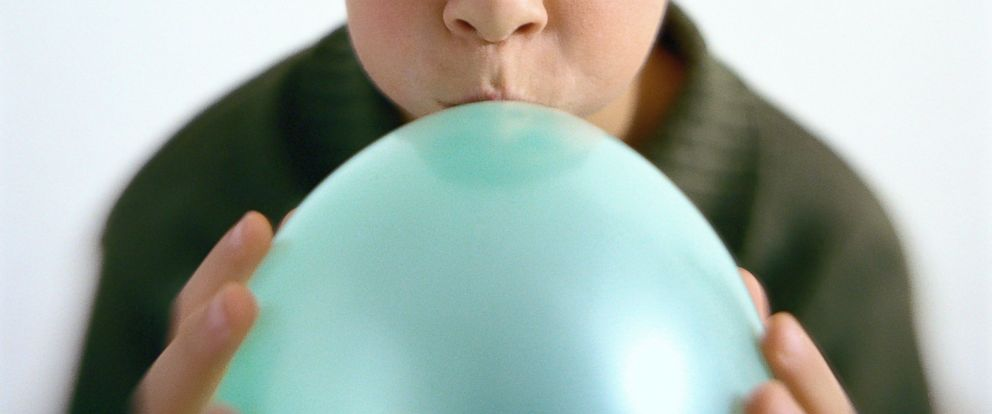 PHOTO: A boy blows up a balloon in an undated stock photo.