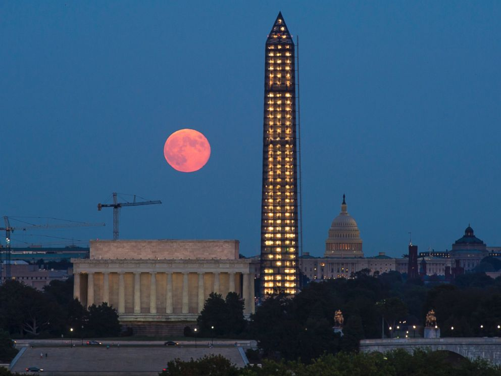 PHOTO: In this handout photo by the National Aeronautics and Space Administration, a full moon, or Harvest Moon, rises over the Lincoln Memorial, the Capitol building and the under-repair Washington Monument on Sept. 19, 2013 in Washington, DC.