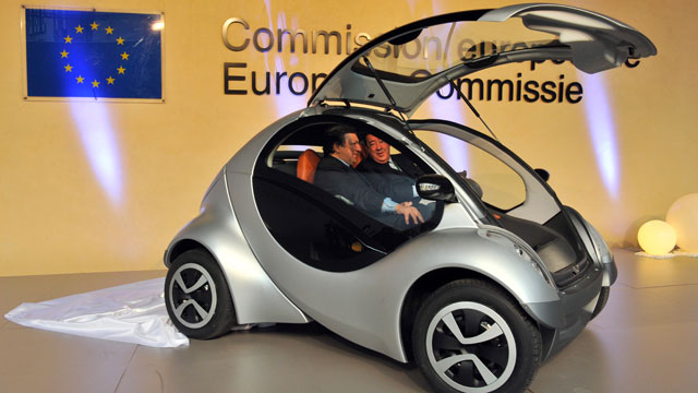 PHOTO: European Commission Chairman Jose Manuel Barroso, right, and the Spanish chairman of Hiriko Driving Mobility, Jesus Echave sit inside the car, Jan. 24, 2012 at EU headquarters in Brussels.
