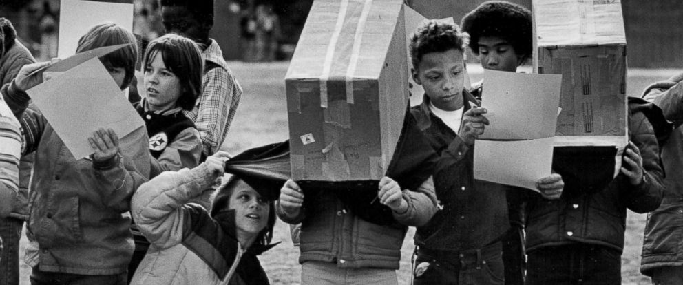 PHOTO: Denver public school students watch a partial solar eclipse using viewing boxes in 1979.