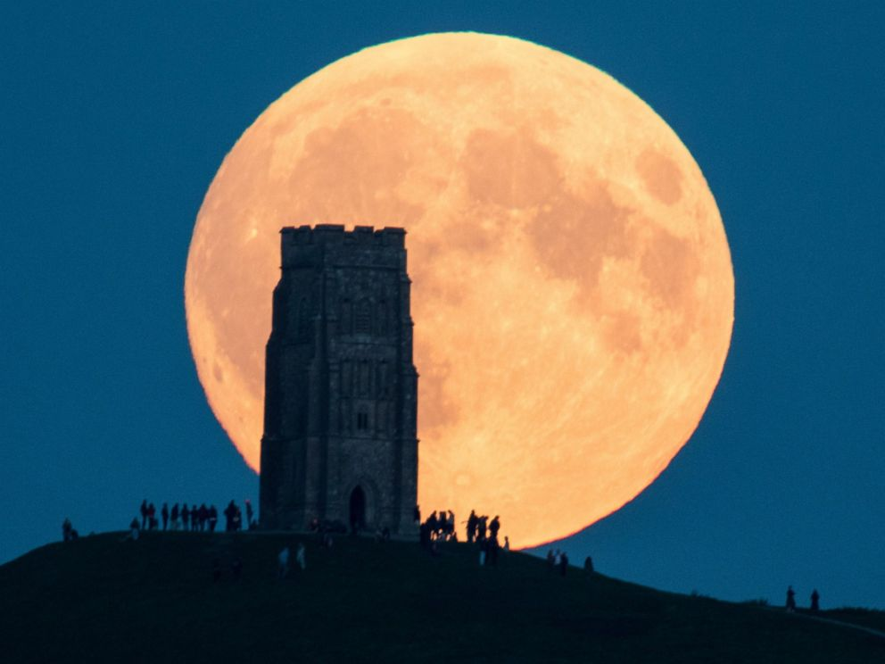 PHOTO: The supermoon rises behind Glastonbury Tor on September 28, 2015 in Somerset, England.