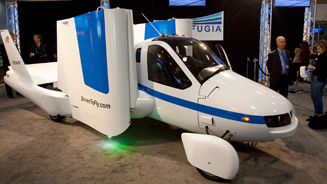 "PHOTO: The Terrafugia Transition ""flying car"" sits on display at the New York International Auto Show in New York, April 4, 2012."