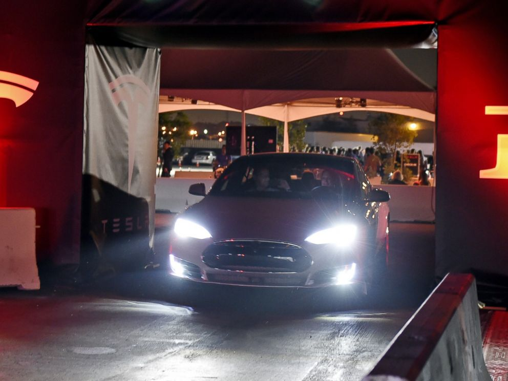 PHOTO: Tesla owners take a ride in the new Tesla D model electric sedan at the Hawthorne Airport on Oct. 09, 2014 in Hawthorne, Calif.