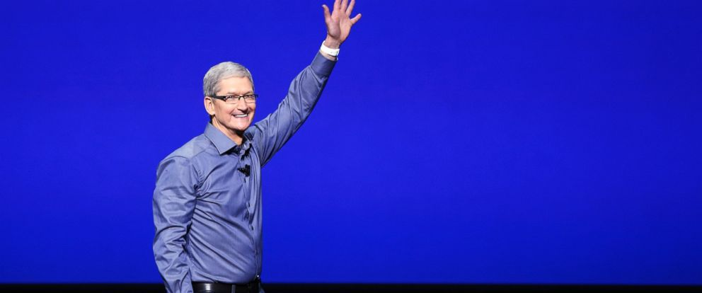 PHOTO: Tim Cook waves as he arrives on stage during an Apple Special Event on at Bill Graham Civic Auditorium Sept. 9, 2015 in San Francisco.