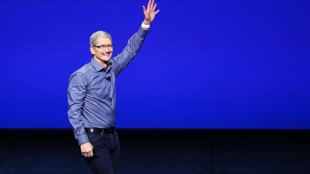 Tim Cook waves as he arrives on stage during an Apple Special Event on at Bill Graham Civic Auditorium Sept. 9, 2015 in San Francisco.