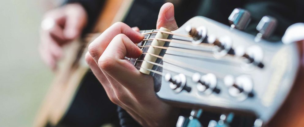 PHOTO: A person plays the guitar in this stock photo.