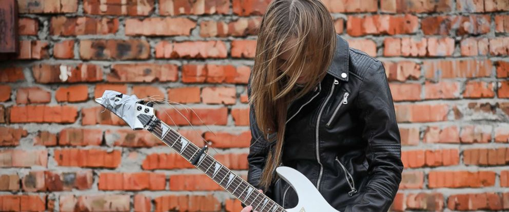 PHOTO: A stock photo of a woman playing guitar.