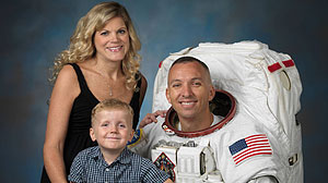 Astronaut Randy Bresnik with wife Rebecca and their three-year-old son Wyatt, shortly after he was assigned to the current flight of the space shuttle Atlantis. Rebecca was due with their second child four days after Randy?s liftoff.